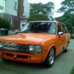 Orange Wagon Parked in Driveway